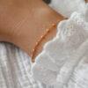 Armbånd med rosa perler